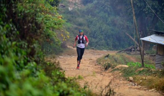 """To go with """"Nepal-Athletics-Gender-Guerilla"""" FEATURE by Paavan MATHEMA In this photograph taken on December 15, 2015, Nepalese athlete Mira Rai takes part in a training session on the hills surrounding Kathmandu. As a child soldier with Nepal's Maoists, Mira Rai learned to fire guns, disarm opponents and race down trails, little imagining her guerrilla drills would help make her one of the world's top ultra runners.  AFP PHOTO / Prakash MATHEMA / AFP / PRAKASH MATHEMA"""