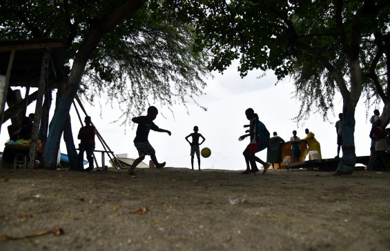 (FILES) This file photo taken on October 03, 2016 shows children play football close to Caira beach in the commune of Leogane, to the southwest from Port-au-Prince, on October 3, 2016.  Hurricane Matthew left over 500 people dead and a trail of destruction in Haiti, but Jolinda Hackett of the award-winning GOALS programme told AFP that morale can be rebuilt through the power of sport.   / AFP PHOTO / HECTOR RETAMAL